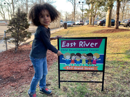 Student with ERCDC sign