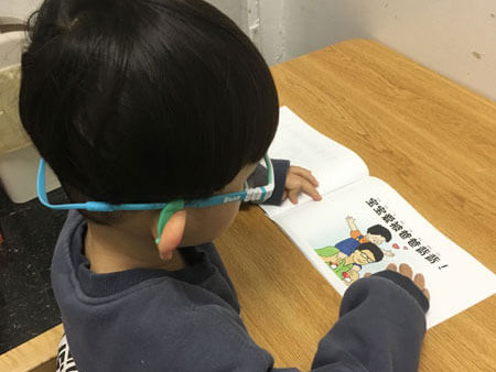 Bilingual boy reading
